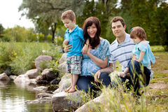 Family Near Lake in Park Royalty Free Stock Image