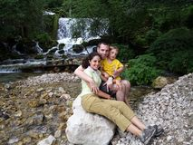 Family near a river Stock Image