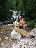 Family near a river. Man and women with a son on summer holiday posing near a little mountain river with waterfalls named ''Vrelo'', in the City of Perucac royalty free stock image