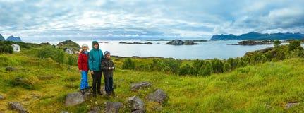 Family near summer Senja coast (Norway, polar night) Royalty Free Stock Photo