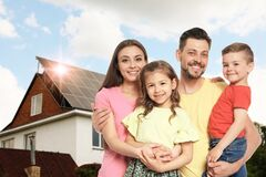 Free Family Near Their House With Solar Panels. Alternative Energy Source Royalty Free Stock Photography - 192498507