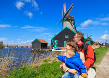 Family near windmill in Holland stock photo