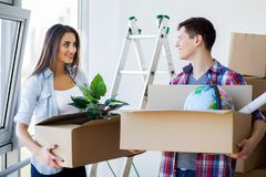 Family New Home Moving Day House Concept.  Stock Photos