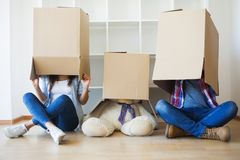 Family New Home Moving Day House Concept.  Stock Photo