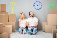 Family New Home Moving Day House Concept. Happy couple at new home. Man and women having fun together. Moving house day and interior renovation concept Royalty Free Stock Image