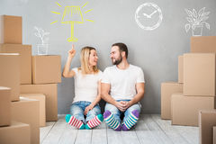 Family New Home Moving Day House Concept. Happy couple at new home. Man and women having fun together. Moving house day and interior renovation concept Royalty Free Stock Photography