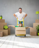 Family New Home Moving Day House Concept. Happy family playing into new home. Father and child having fun together. Moving house day and express delivery concept Royalty Free Stock Photography