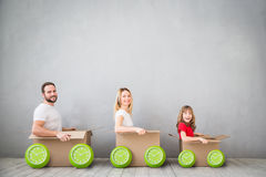 Family New Home Moving Day House Concept. Happy family playing into new home. Father, mother and child having fun together. Moving house day and express delivery Royalty Free Stock Photo