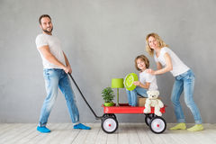 Family New Home Moving Day House Concept. Happy family playing into new home. Father, mother and child having fun together. Moving house day and express delivery royalty free stock photos