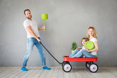 Family New Home Moving Day House Concept. Happy family playing into new home. Father, mother and child having fun together. Moving house day and express delivery Royalty Free Stock Images