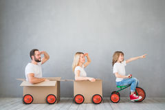 Family New Home Moving Day House Concept. Happy family playing into new home. Father, mother and child having fun together. Moving house day and express delivery stock photos