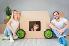Family New Home Moving Day House Concept. Happy family playing into new home. Father, mother and child having fun together. Moving house day and real estate Stock Photography