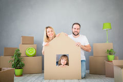 Family New Home Moving Day House Concept. Happy family playing into new home. Father, mother and child having fun together. Moving house day and real estate royalty free stock photos