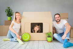 Family New Home Moving Day House Concept. Happy family playing into new home. Father, mother and child having fun together. Moving house day and real estate Royalty Free Stock Image