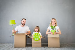 Family New Home Moving Day House Concept. Happy family playing into new home. Father, mother and child having fun together. Moving house day and real estate Stock Photo