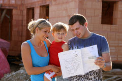 Family and new house. Family with plan and new house Royalty Free Stock Photography