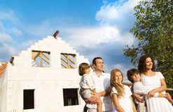 Family with new house Royalty Free Stock Photos