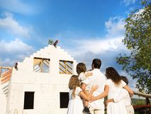 Family with new house Stock Images