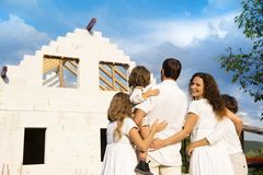 Family with new house Stock Image