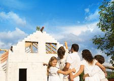 Family with new house Royalty Free Stock Photography