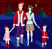 Family in the New Year costumes Royalty Free Stock Photography
