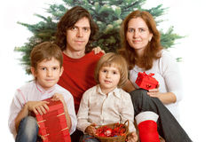 Family with new year presents Royalty Free Stock Photos