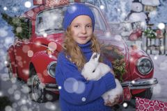 Family New Year`s concept. Portrait of a cute blond girl. royalty free stock photo
