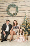 Family new year's eve around the Christmas tree Stock Image