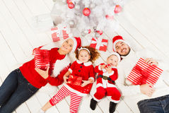 Family and New year tree with presents stock image