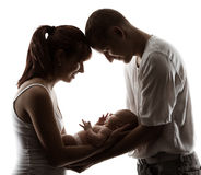 Family with newborn baby. Parents silhouette over white. Background. Child birth concept Stock Photos