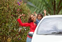 Family next to a car Royalty Free Stock Images