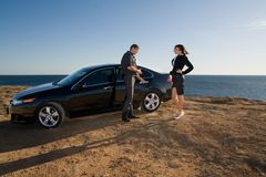 Family next to his car. A happy family beside their new kind of cars Royalty Free Stock Image
