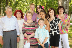 Family of nine people pose at park Stock Images