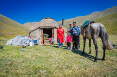 Family with nomad tent in Kyrgyzstan Royalty Free Stock Images