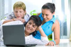 Family with notebook Stock Image