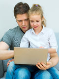 Family with notebook. Royalty Free Stock Photo