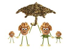 Family nuts under the umbrella Stock Photos