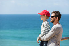 Family by the ocean Stock Images