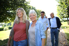 Family Of Adulty Walking In Park Royalty Free Stock Photo