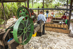 Family Of Farmers Working In The Trapiche Royalty Free Stock Image