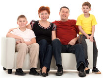 Family Of Four On A Sofa Stock Image