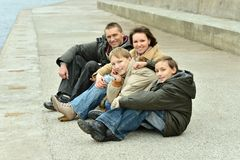Family Of Four Sitting Stock Images