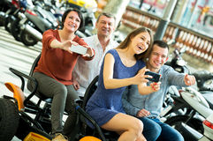 Family Of Four Sitting In Grand Tour Electric Stock Photo