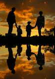 Family Of Four Sunset Water Royalty Free Stock Images