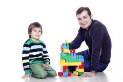Family Of Two Playing Lego Stock Photo