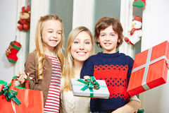 Family offering gift at christmas Stock Image