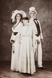 Family of the old times. Family of the past times - married couple in secession style dresses with daughter Royalty Free Stock Images