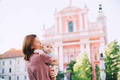 Family in Old Town Center of Ljubljana, Slovenia. Beautiful young mother with baby child spend time in the old town of Ljubljana, Slovenia, Europe. Mother and stock image