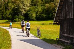 Family On Cycle Ride In Countryside Track, Bohinj Stock Photos