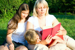 Family On Grass Stock Photography